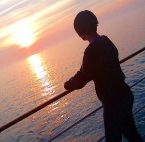 girl silhouette cruise ship sunset view sea