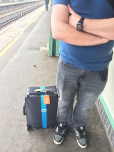 packing light two weeks in a cabin bag train station suitcase