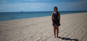 girl in dress on fort lauderdale beach sandy blue sky