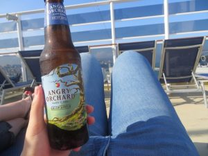 cruising isn't just for old people cider drink alcohol package ncl ultimate beverage package on deck jeans girl