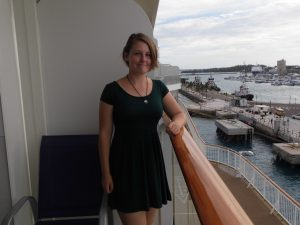 cruising isn't just for old people young cruiser balcony girl in dress 20s green dress norwegian breakaway