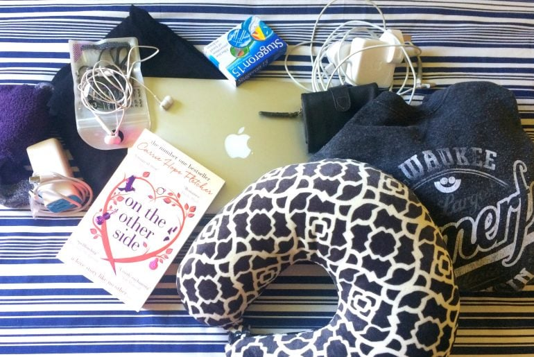 Whats in my hand luggage book headphones plane travel pillow jumper socks macbook travel sickness pills