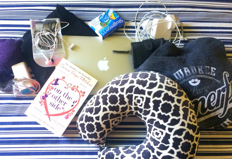 Whats in my hand luggage book headphones plane travel pillow jumper socks macbook travel sickness pills