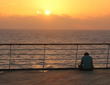 carnival sensation early morning sunrise over deck and ocean sea sitting
