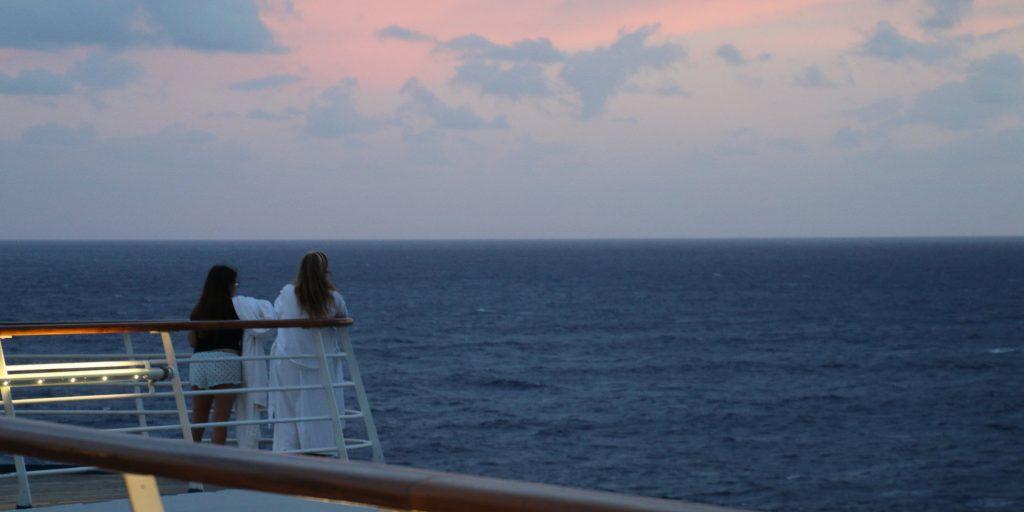 carnival sensation sunrise cruise ship morning breakfast red sky over ocean