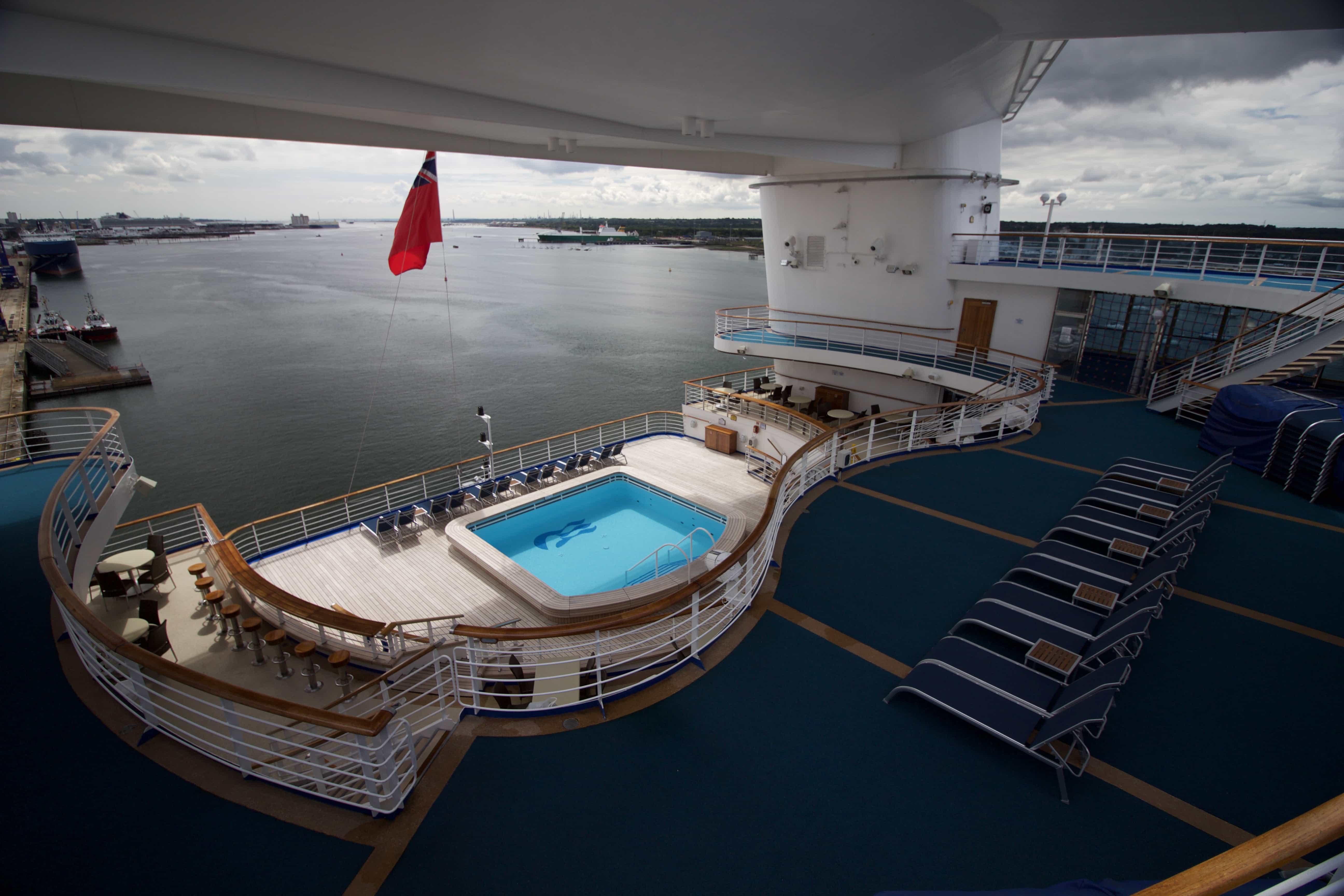 Caribbean Princess Aft Pools Sun Beds View Flag Pool Bar