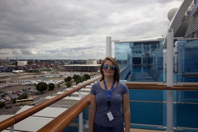 Caribbean Princess girl selfie on deck sunglass medium brown hair cruise ship deck promenade balcony
