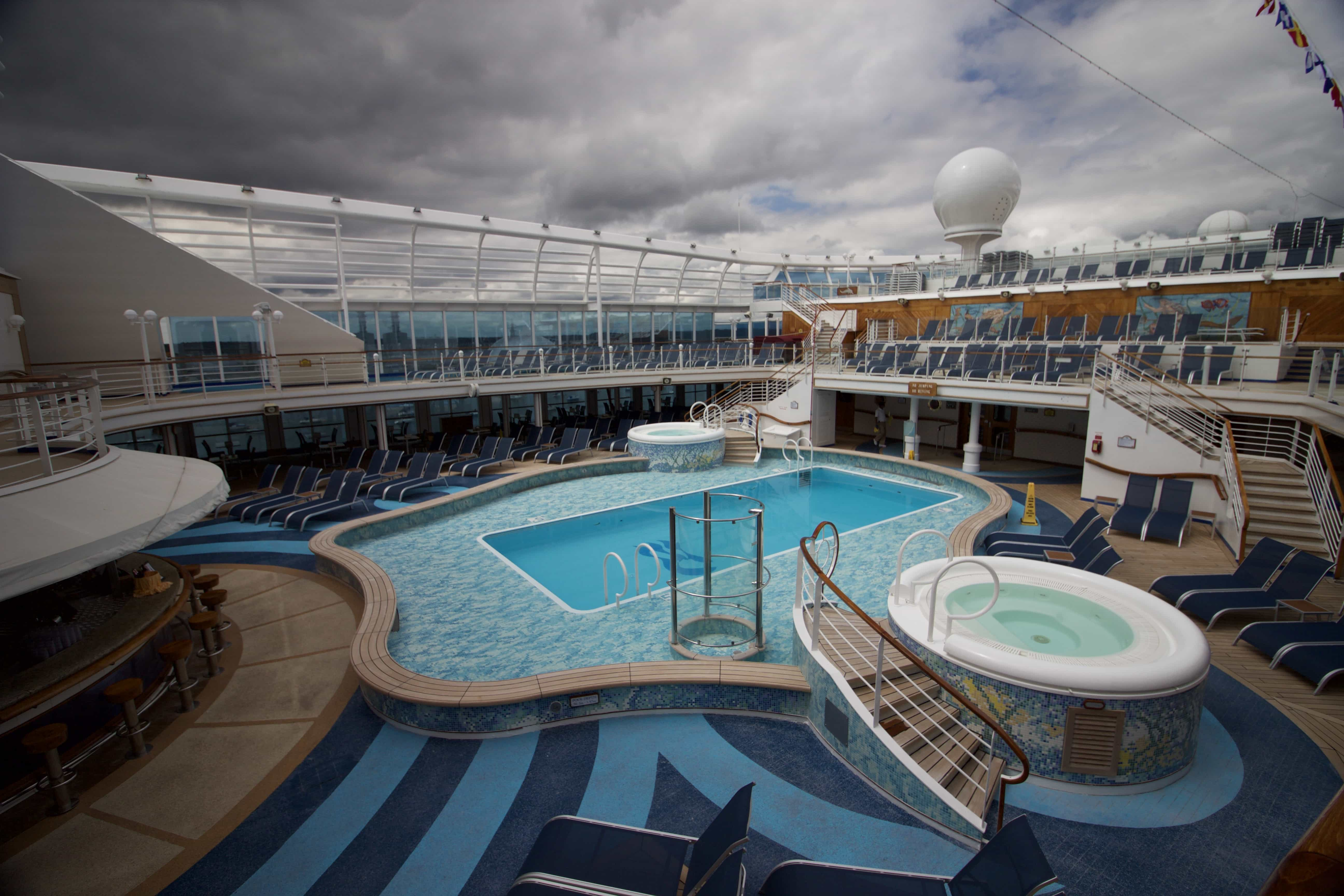 Caribbean Princess swimming pools hot tub deck chairs sun bathing centre