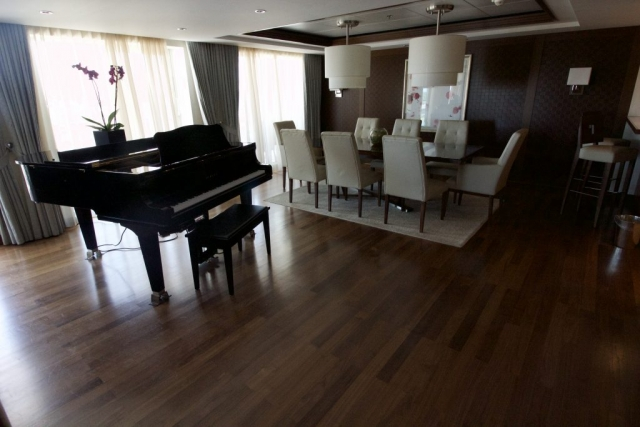 Celebrity Eclipse - Penthouse suite, grand piano dining room kitchen chairs cebin