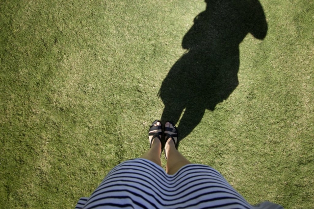 Celebrity Eclipse - Lawn club grass feet cruise ship shadow stripey dress