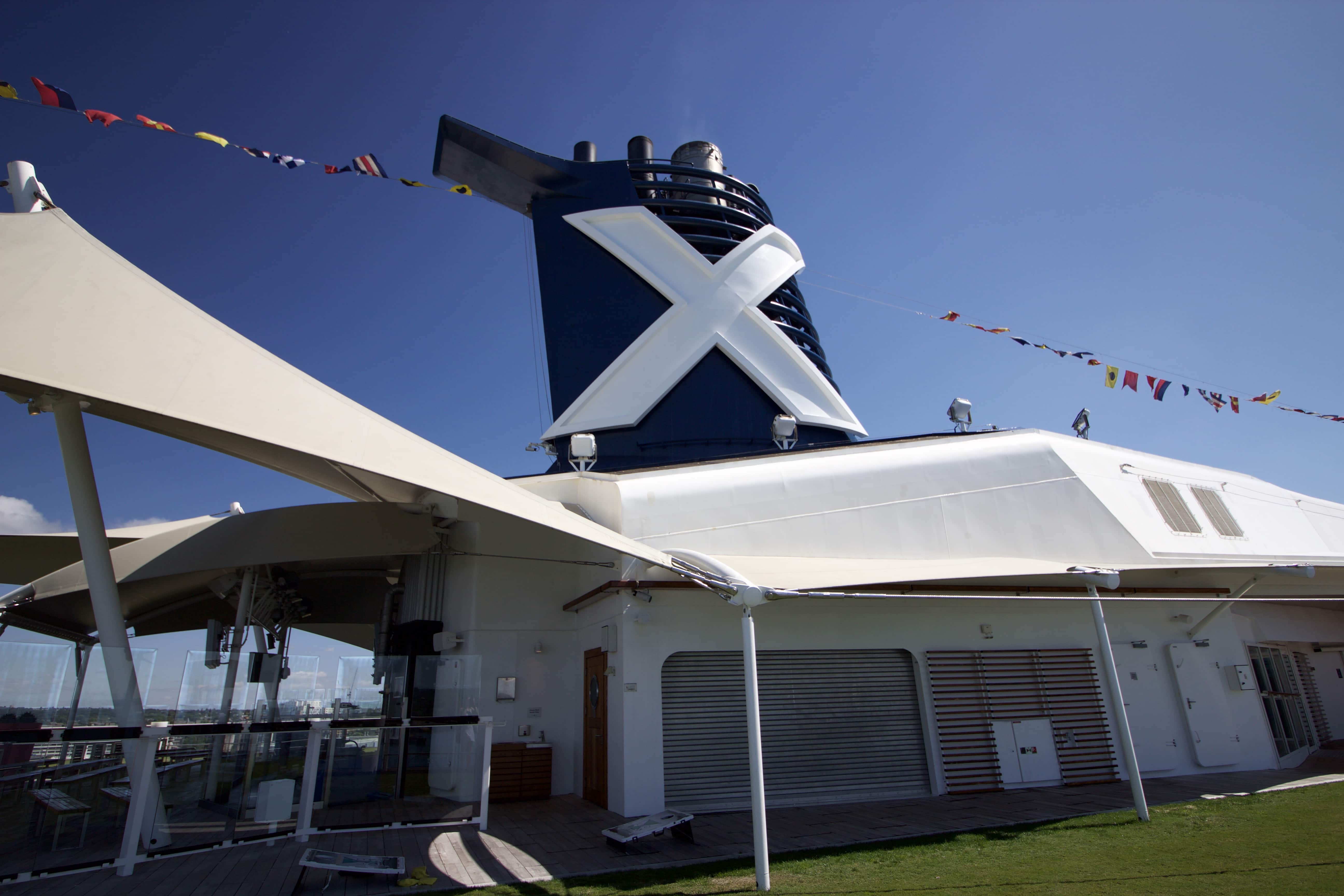 Celebrity Eclipse - Funnel X flags grass lawn club