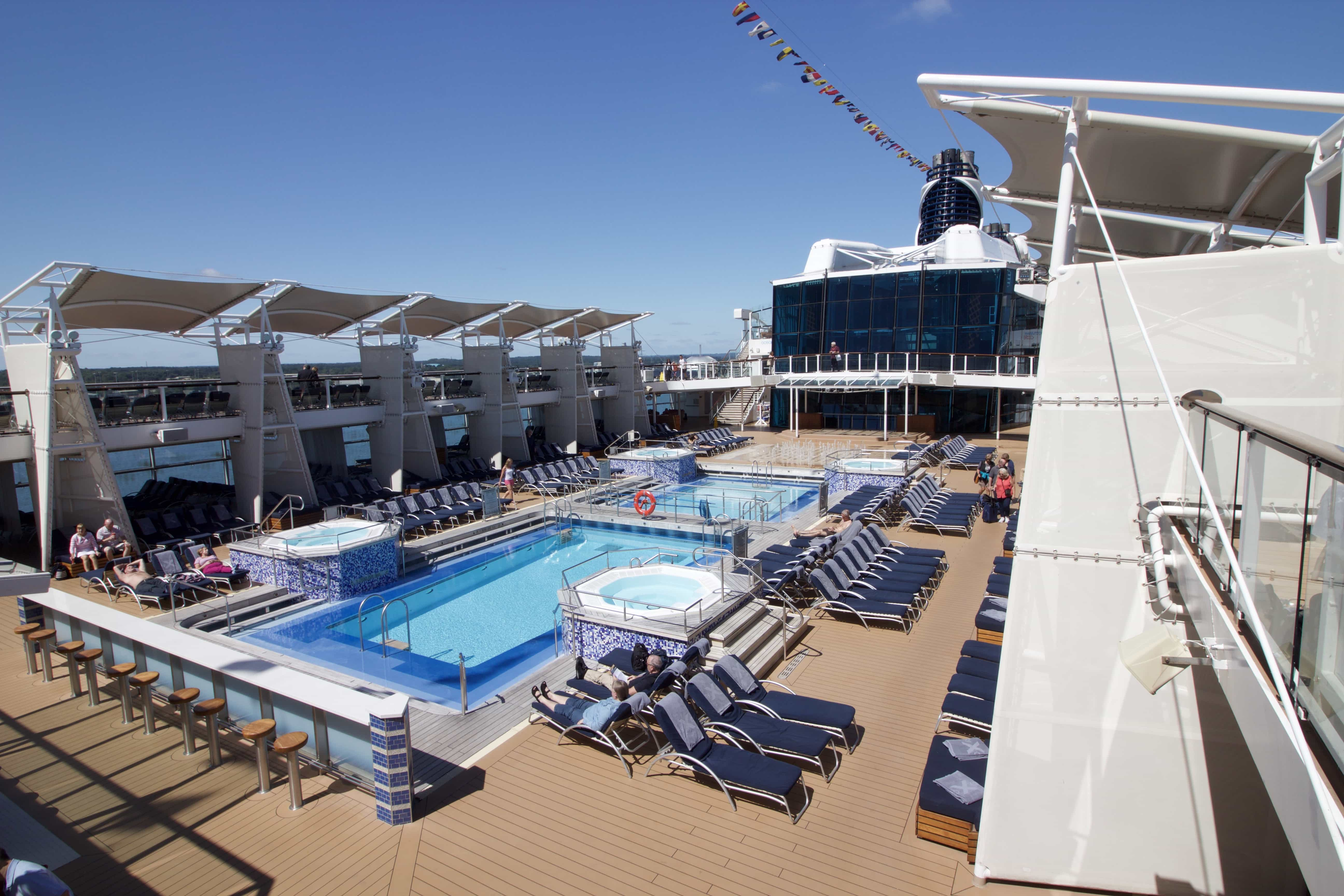Celebrity Eclipse - Swimming pools deck sun beds sunbathing hot tubs