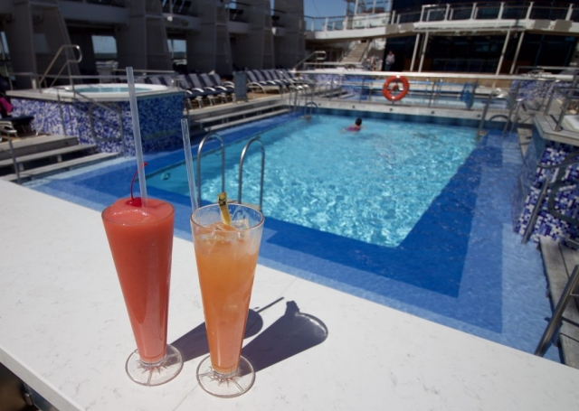 Celebrity Eclipse - Drinks by the pool! cocktails fruit punch swimming pool hot tub cruise ship deck sun bathing sun beds