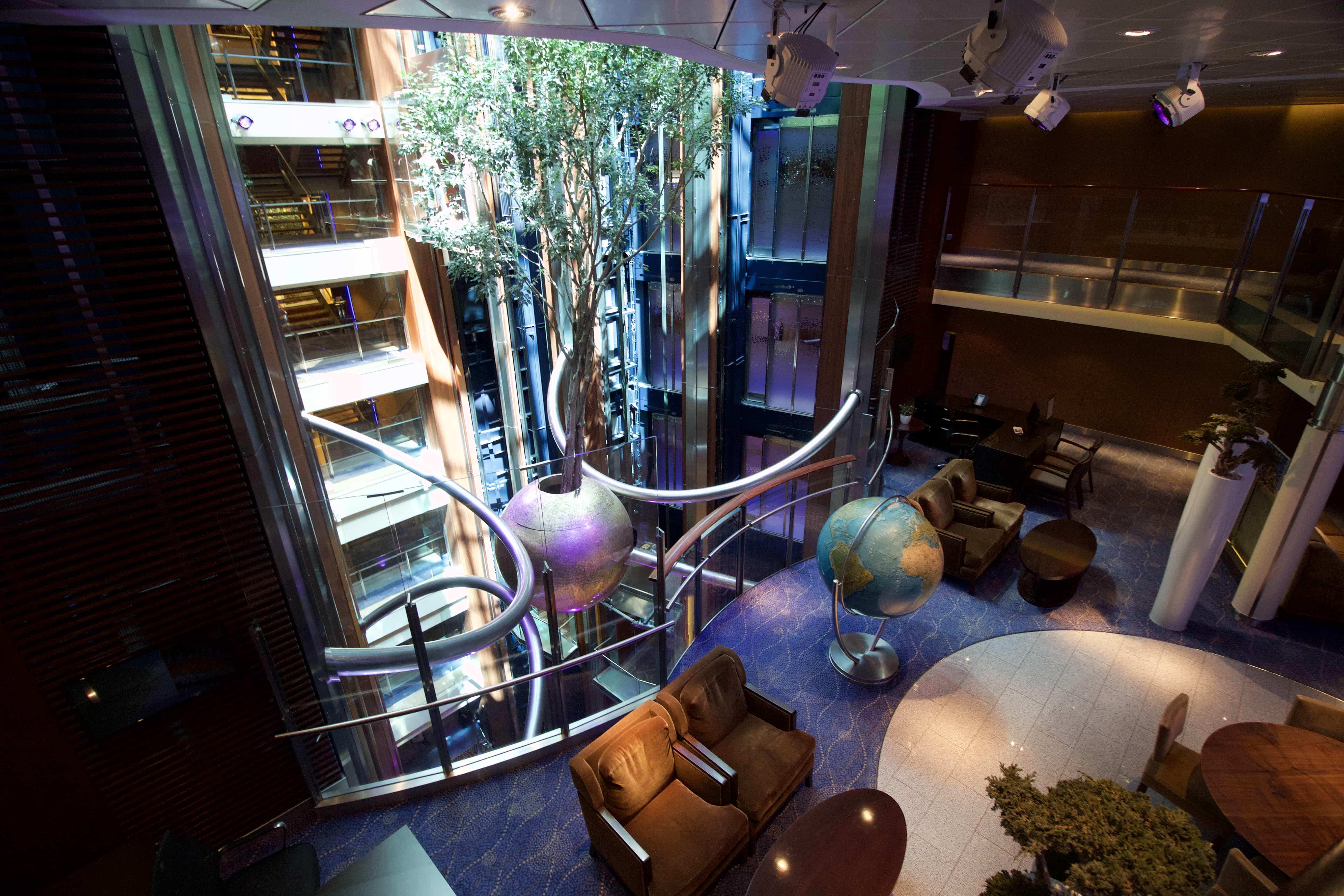 Celebrity Eclipse - Tree in atrium! world globe sofas lifts