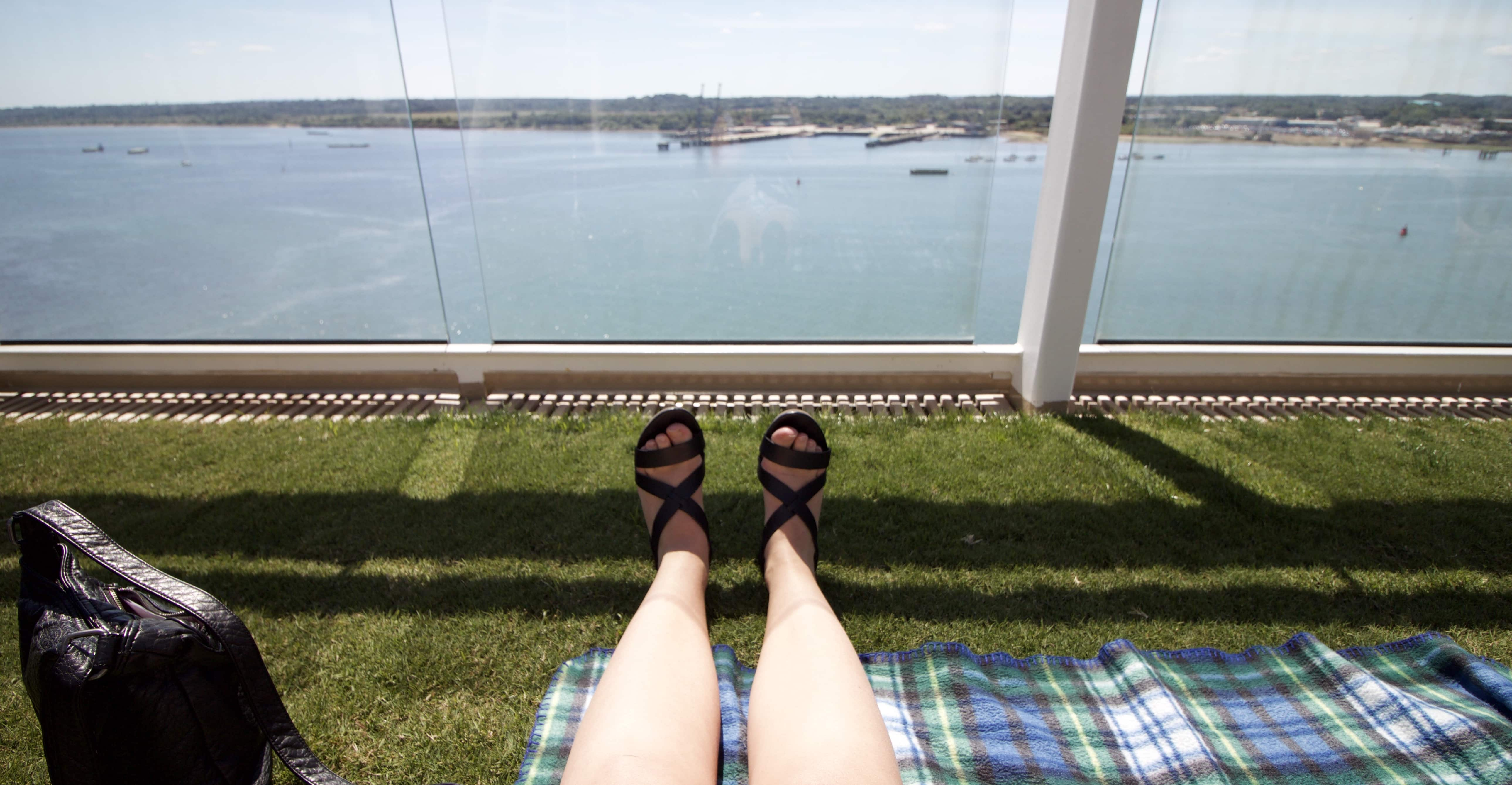 Celebrity Eclipse - Lawn Club grass picnic blanket feet sandals view