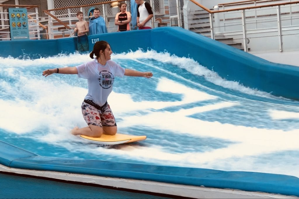 me on the flowrider royal caribbean independence of the seas girl kneeling surfing board shorts
