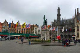 bruges belgium town square flags gothic