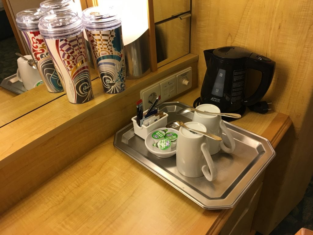 independence of the seas inside cabin kettle tea and coffee soda package cups