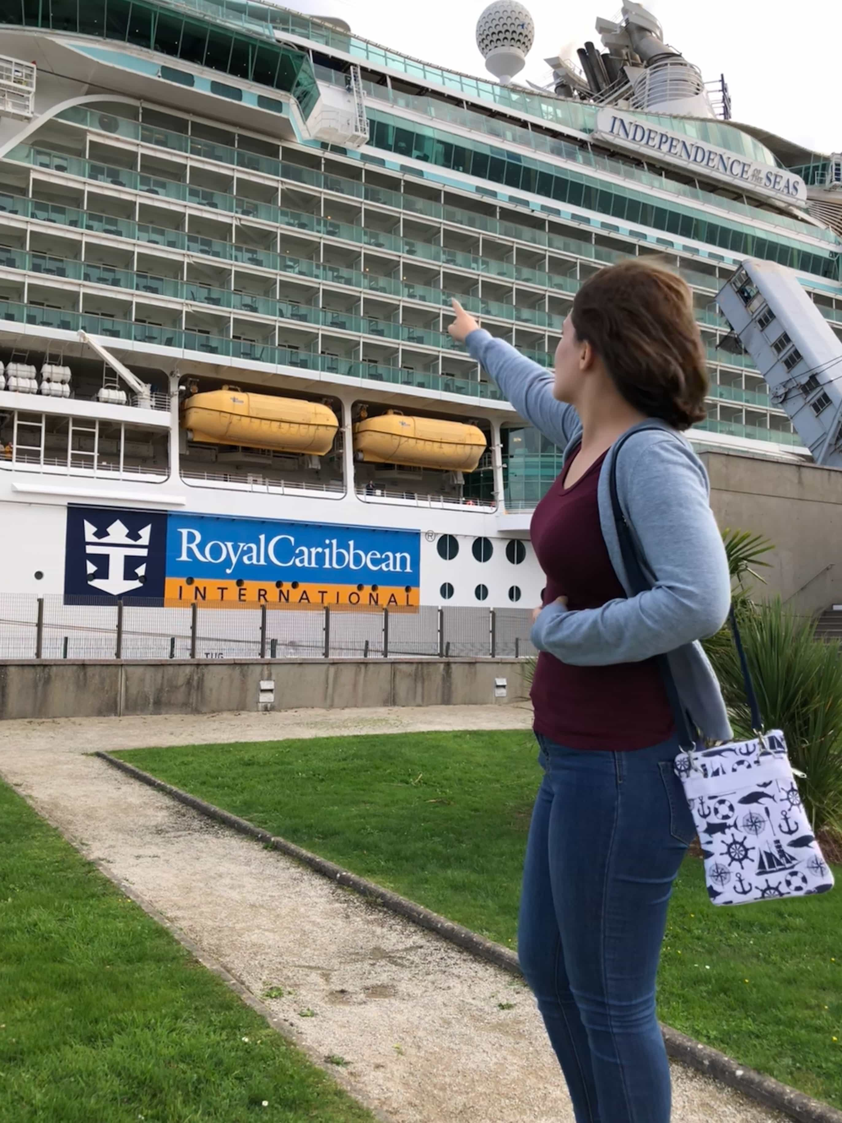 royal caribbean independence of the seas girl pointing at cruise ship nautical bag