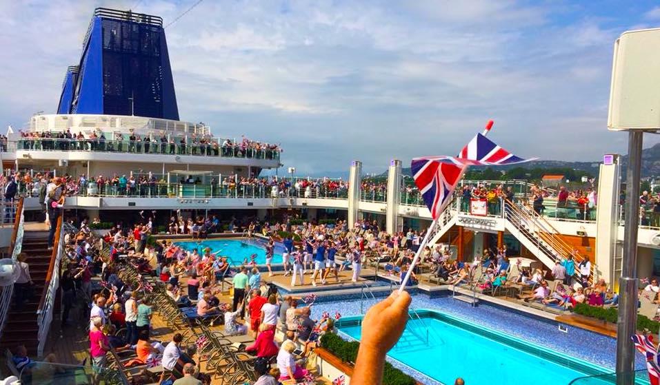 britannia sail away party p&o cruises top deck union jack flag UK
