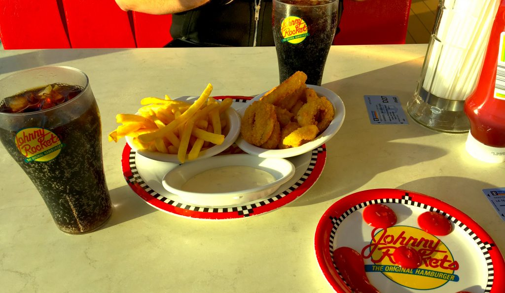Johnny Rockets starters fries and onion rings ketchup smiley face on plate