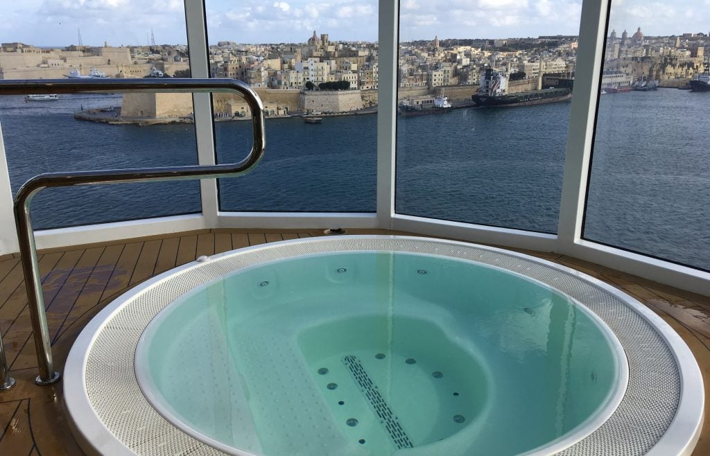 view of malta from the msc meraviglia hot tub in foreground
