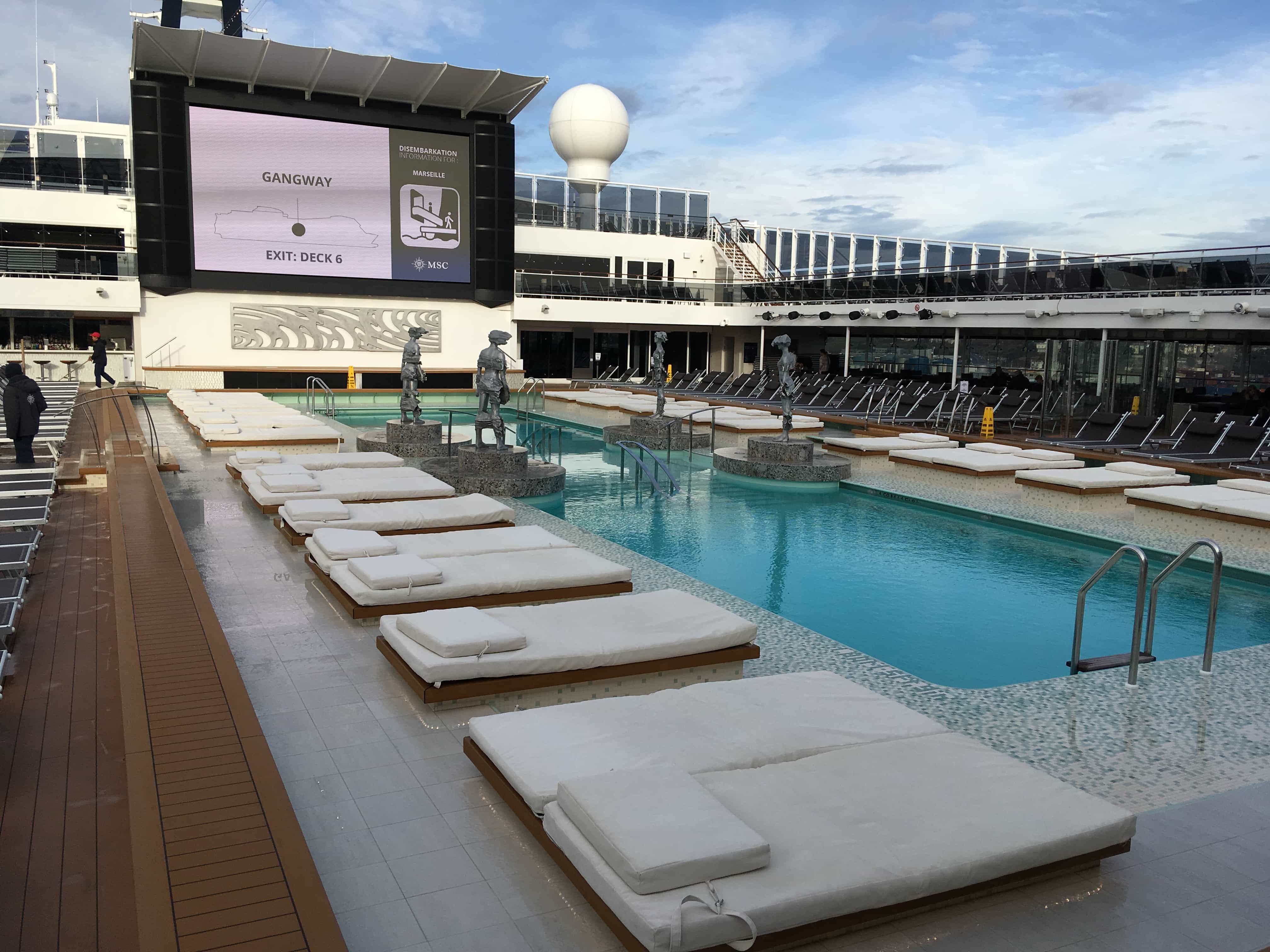 msc meraviglia pool deck swimming sunloungers screen