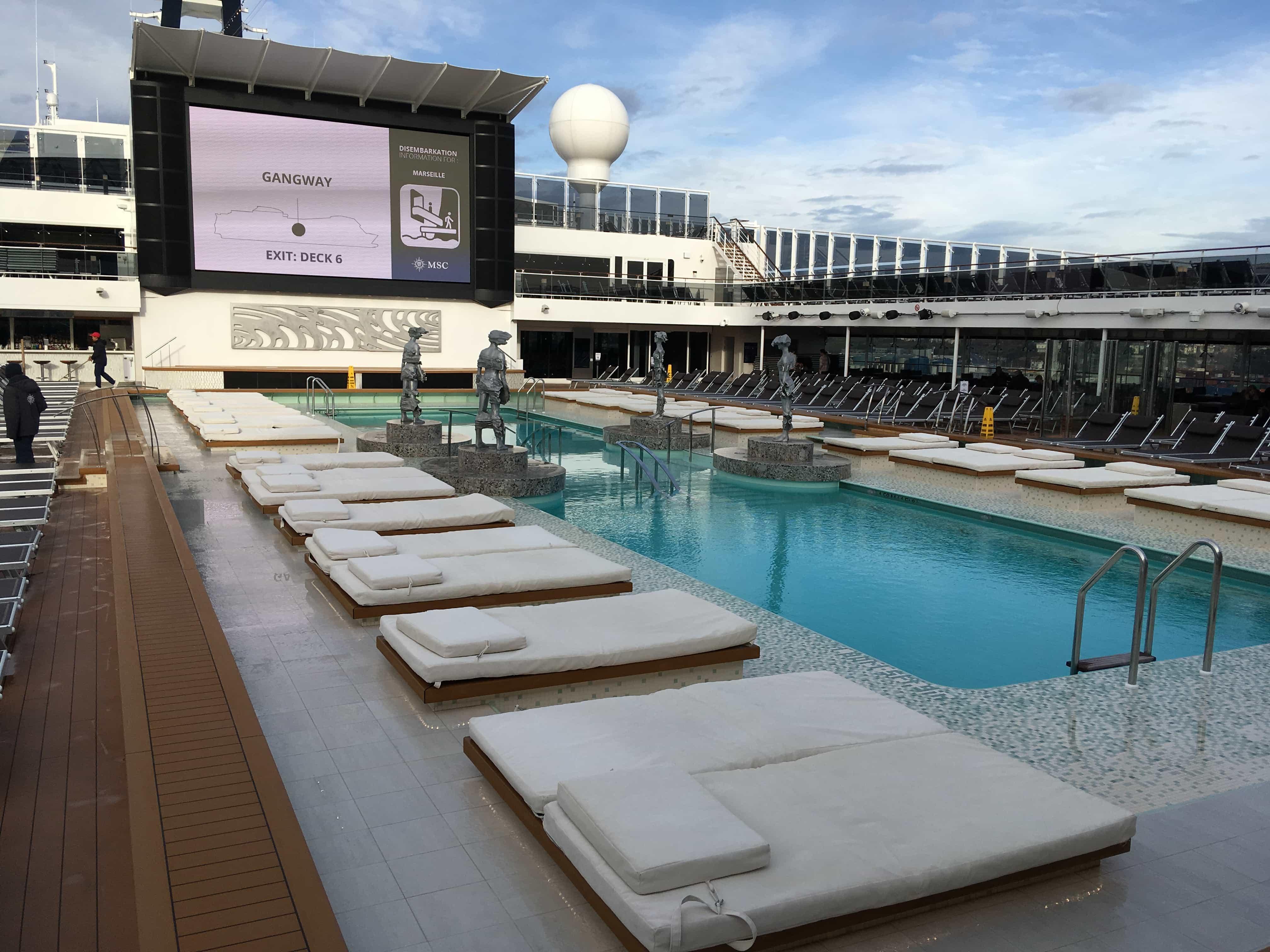 msc meraviglia pool deck swimming sunloungers screen