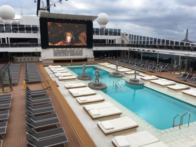 msc meraviglia pool deck top swimming pools sun loungers fish on screen