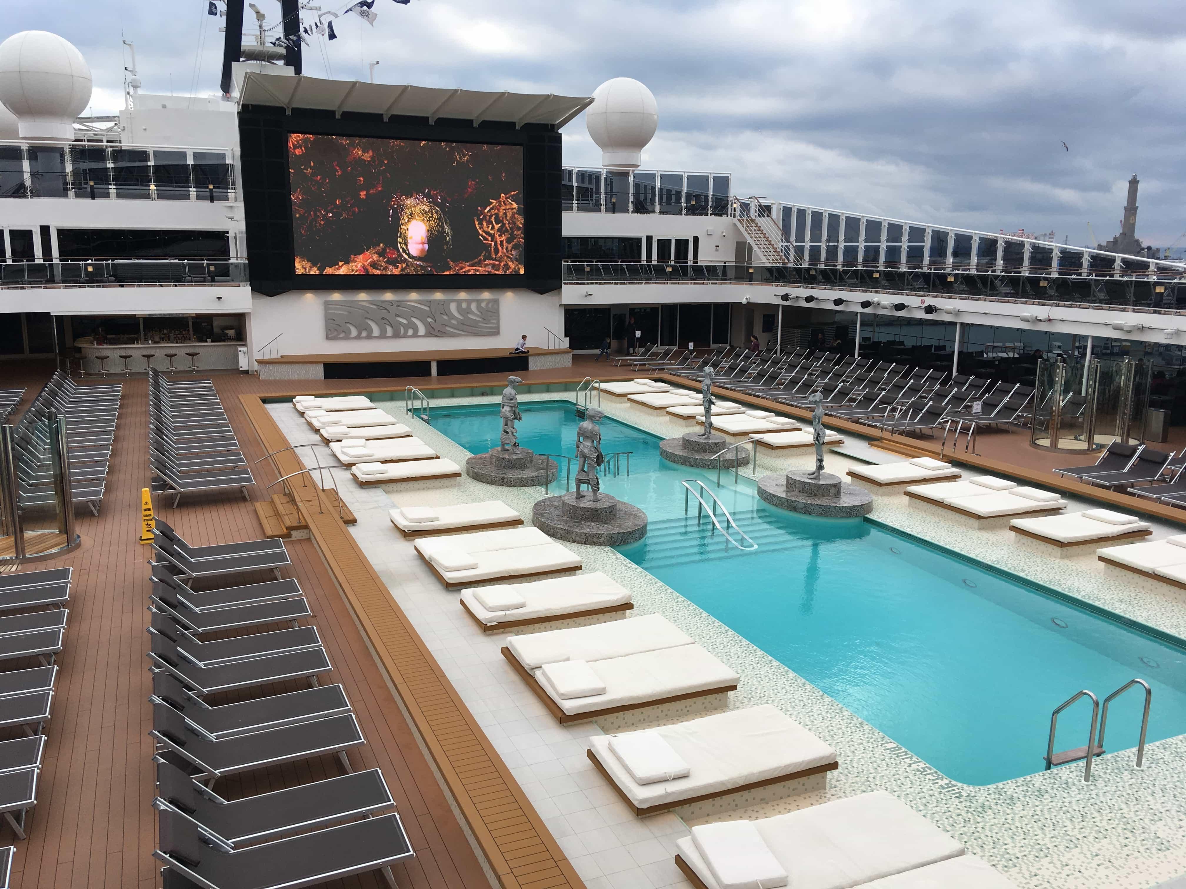 msc meraviglia pool deck top swimming pools sun loungers fish on screen
