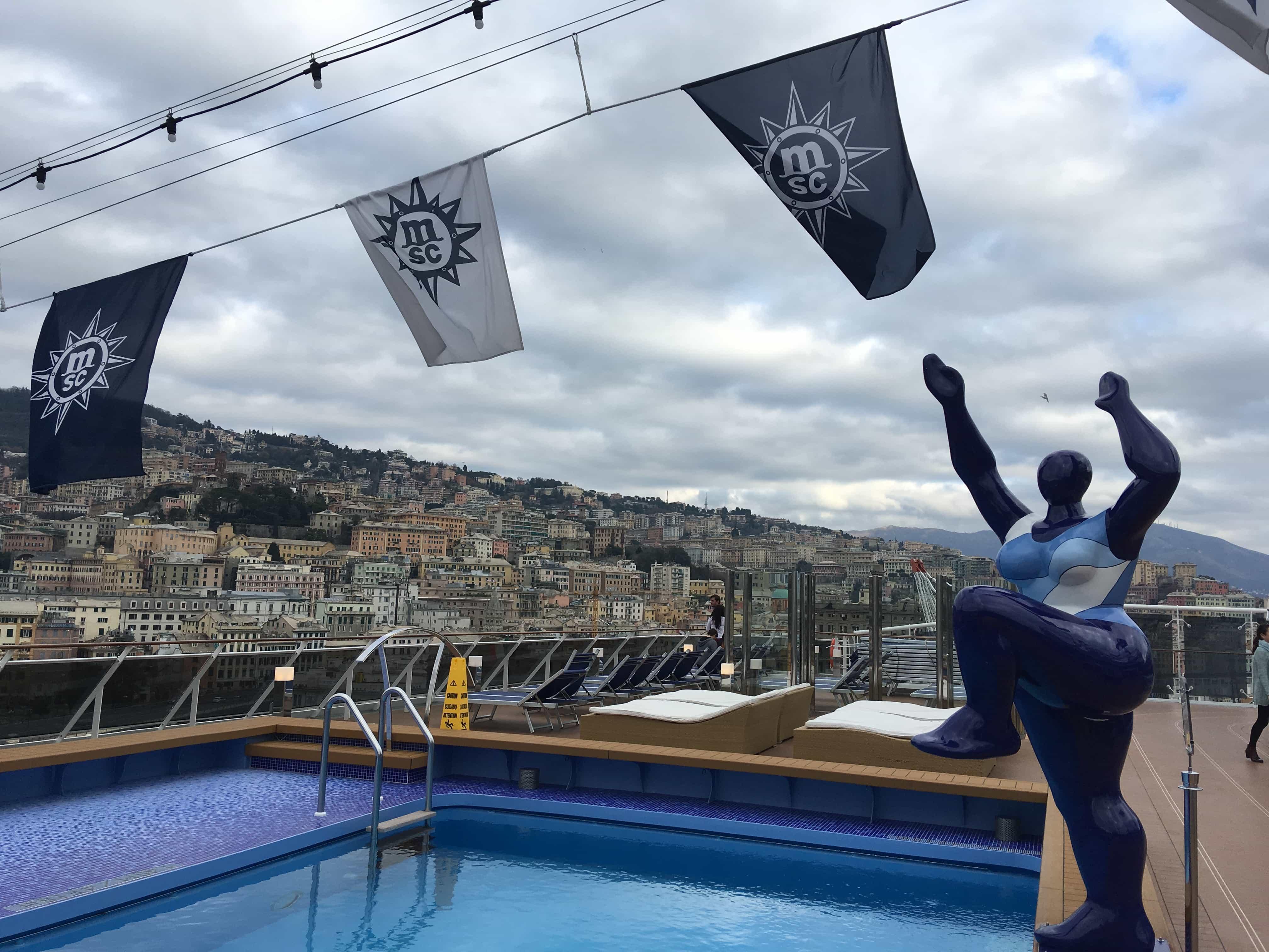 msc meraviglia aft pool sculpture flats genoa in the background