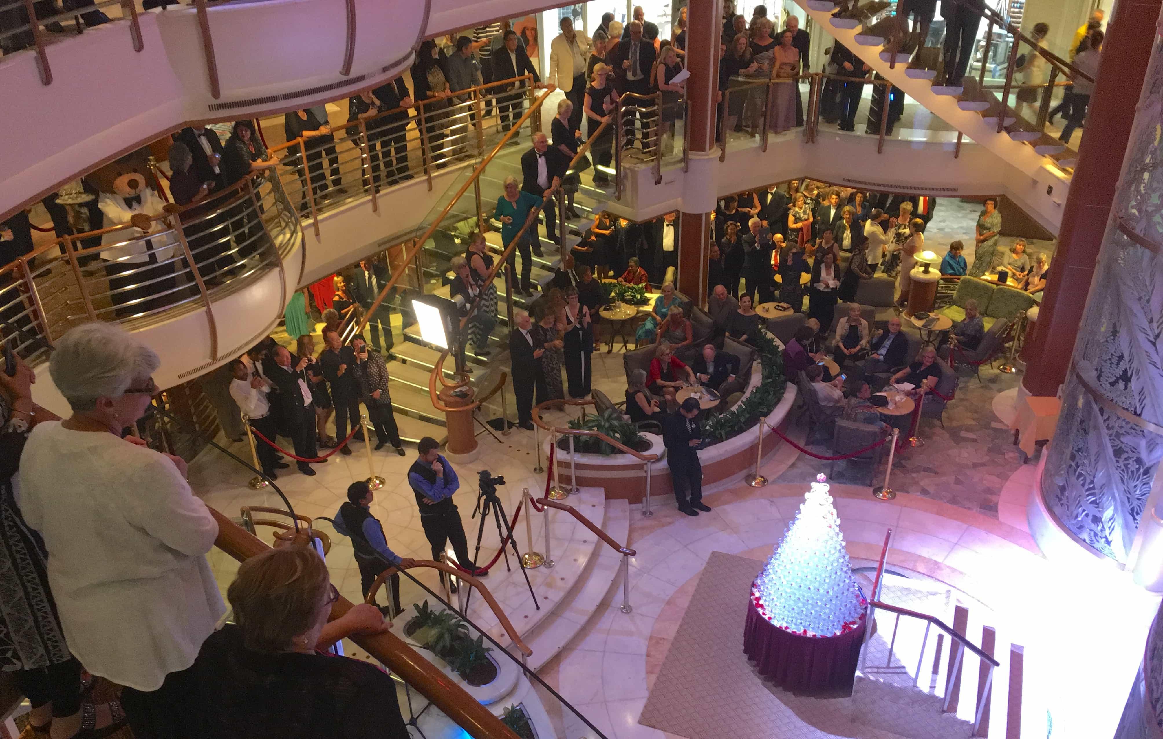 passengers watching champagne waterfall golden princess atrium piazza