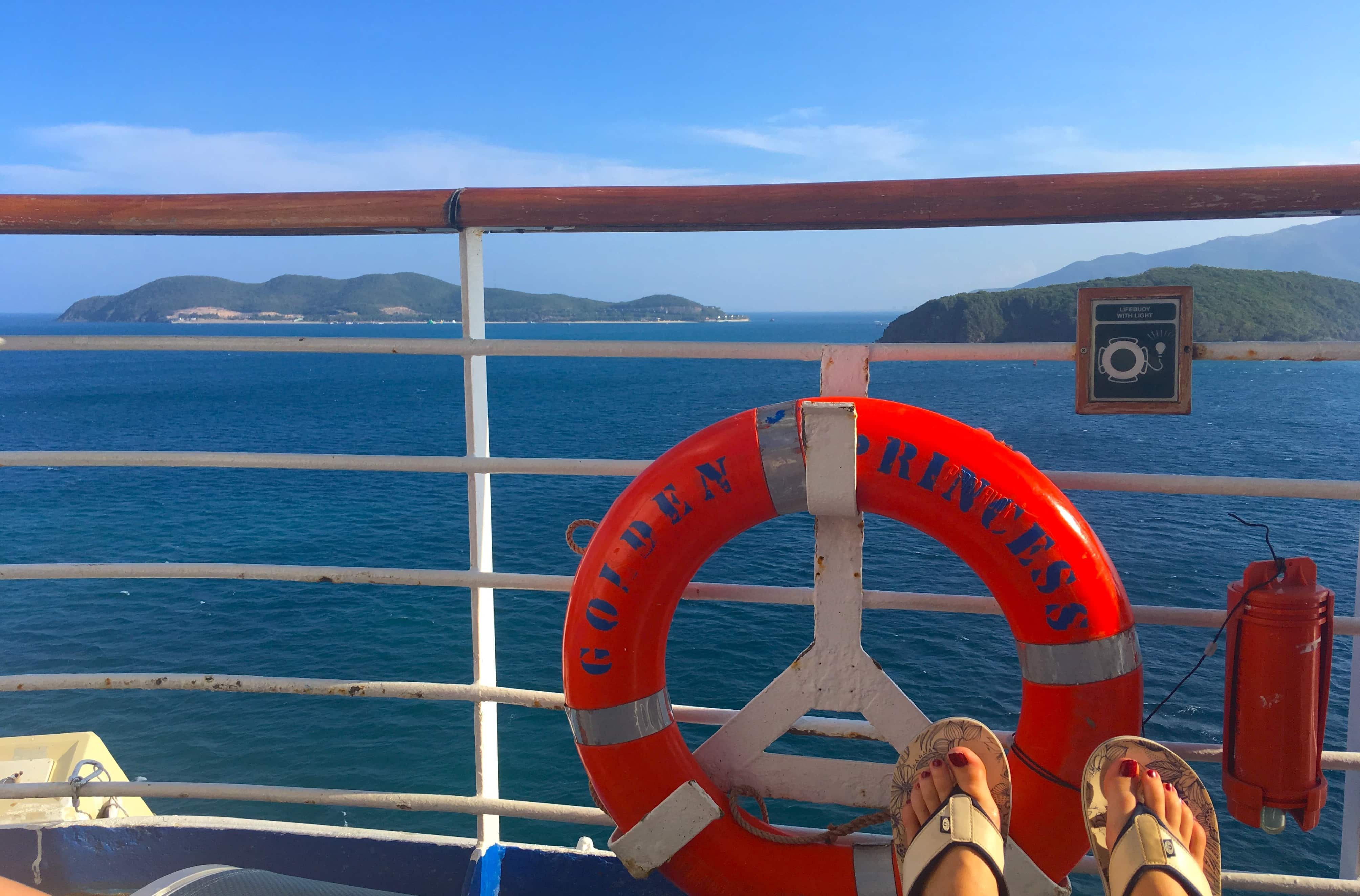 Golden Princess Life Buoy View of Asia Blue Skies Ocean Flip Flops