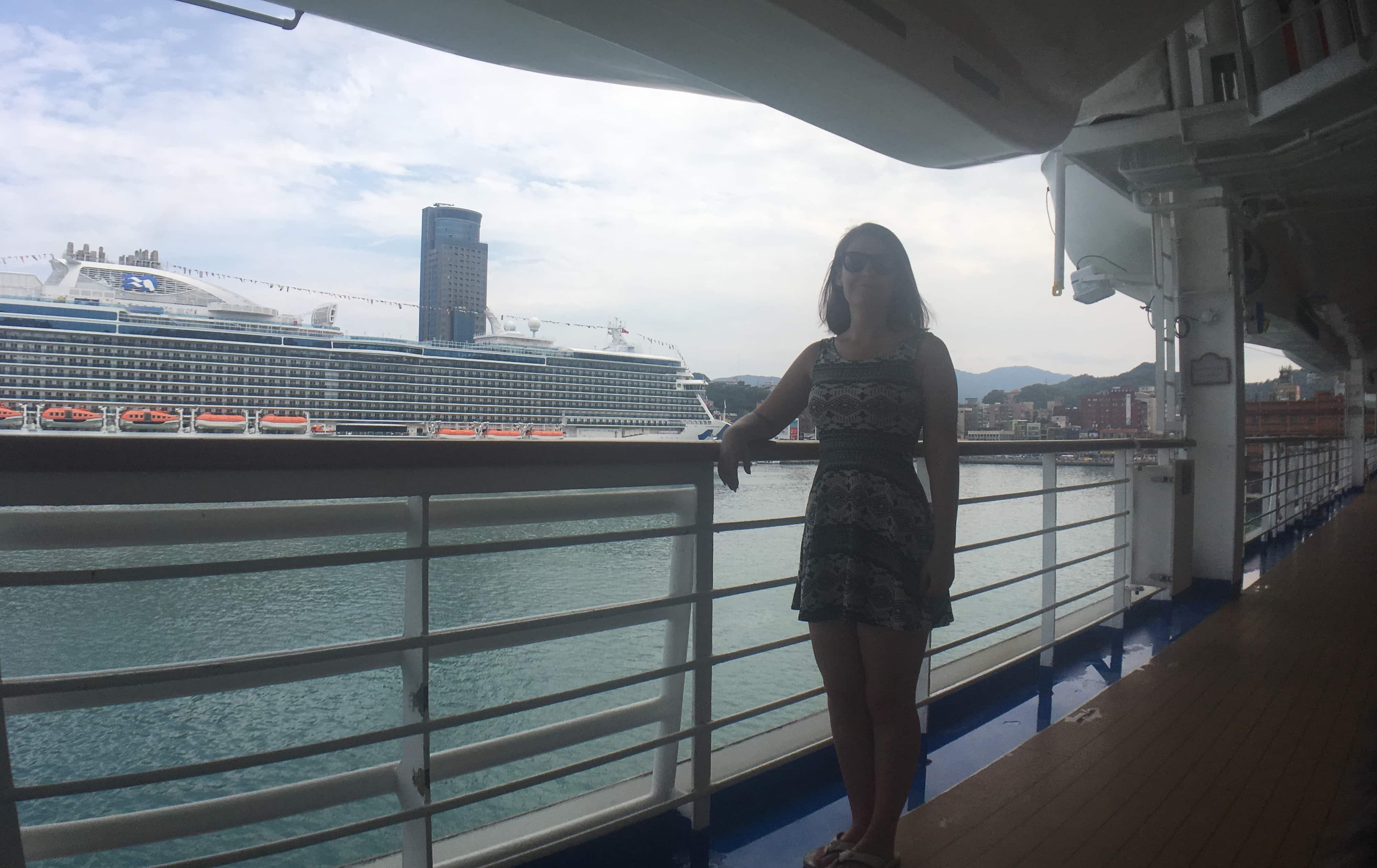 Promenade Deck Golden Princess girl dress standing railing