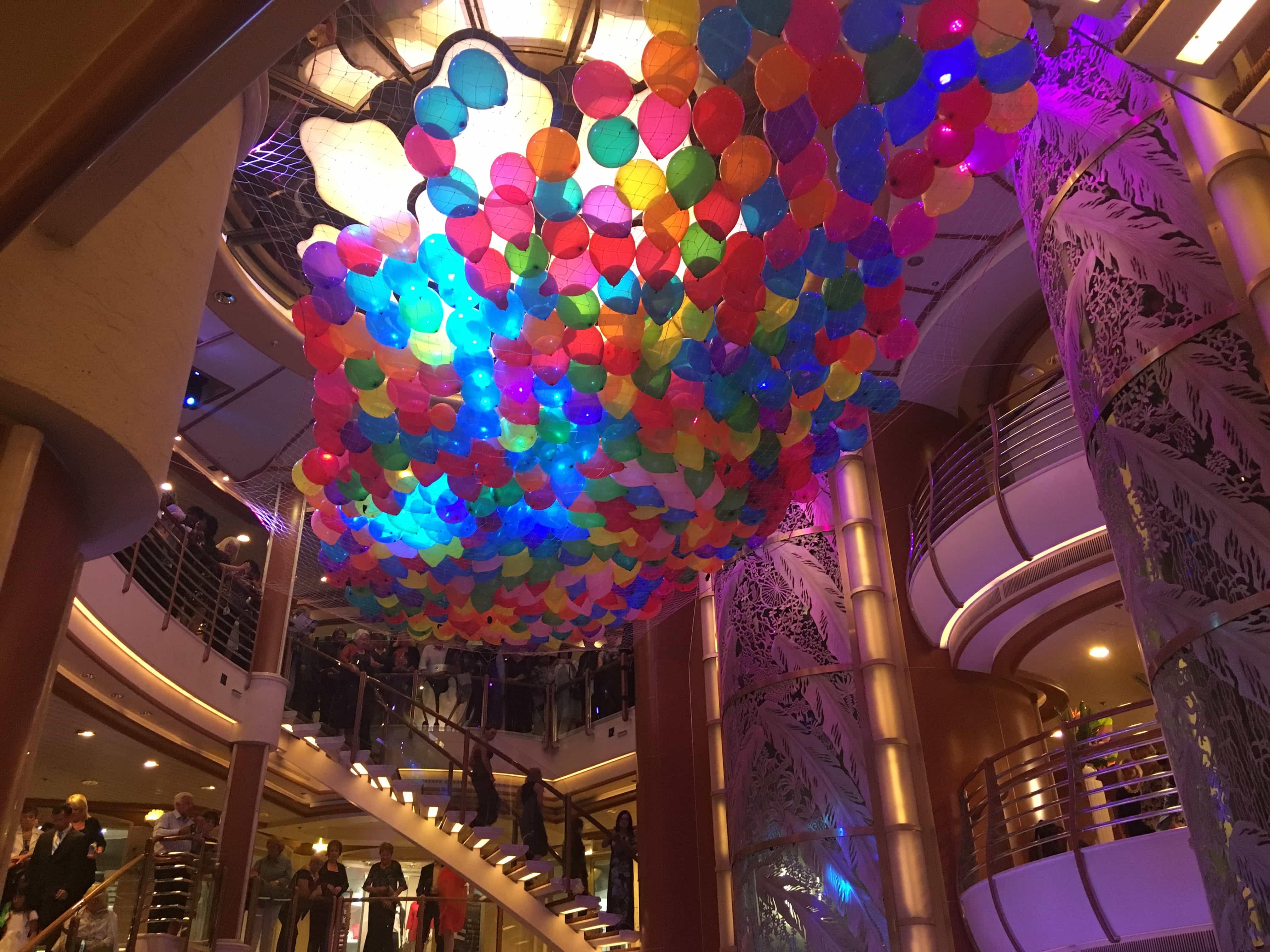 golden princess balloon drop party atrium piazza staircase