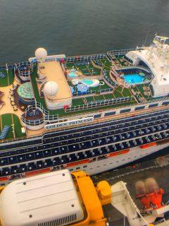 Golden princess Cruise ship aerial view swimming pools top decks green grass carpet