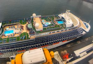 Golden princess Cruise ship aerial view swimming pools top decks green grass carpet