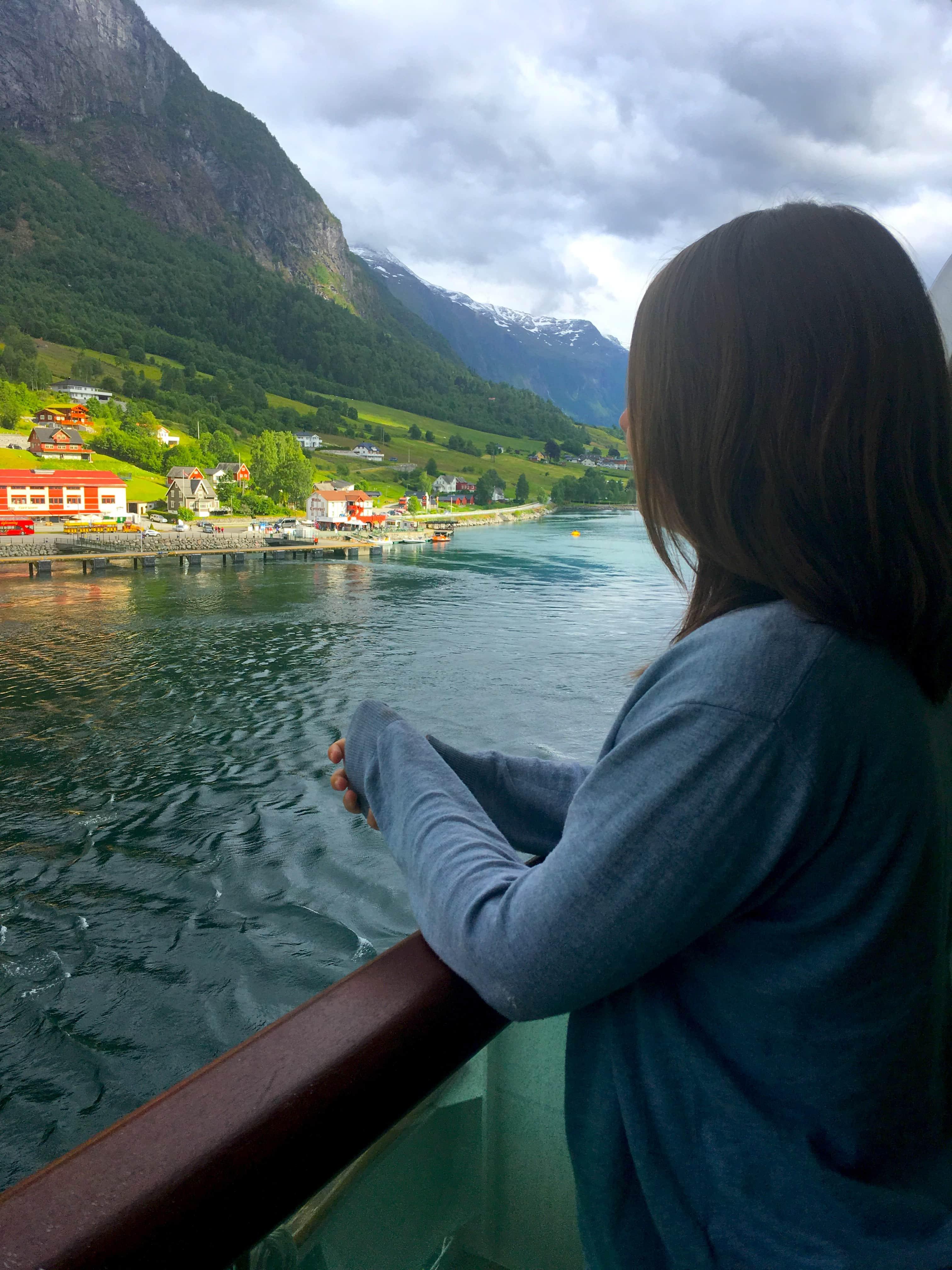 norwegian fjords balcony view girl norway cruise ship britannia