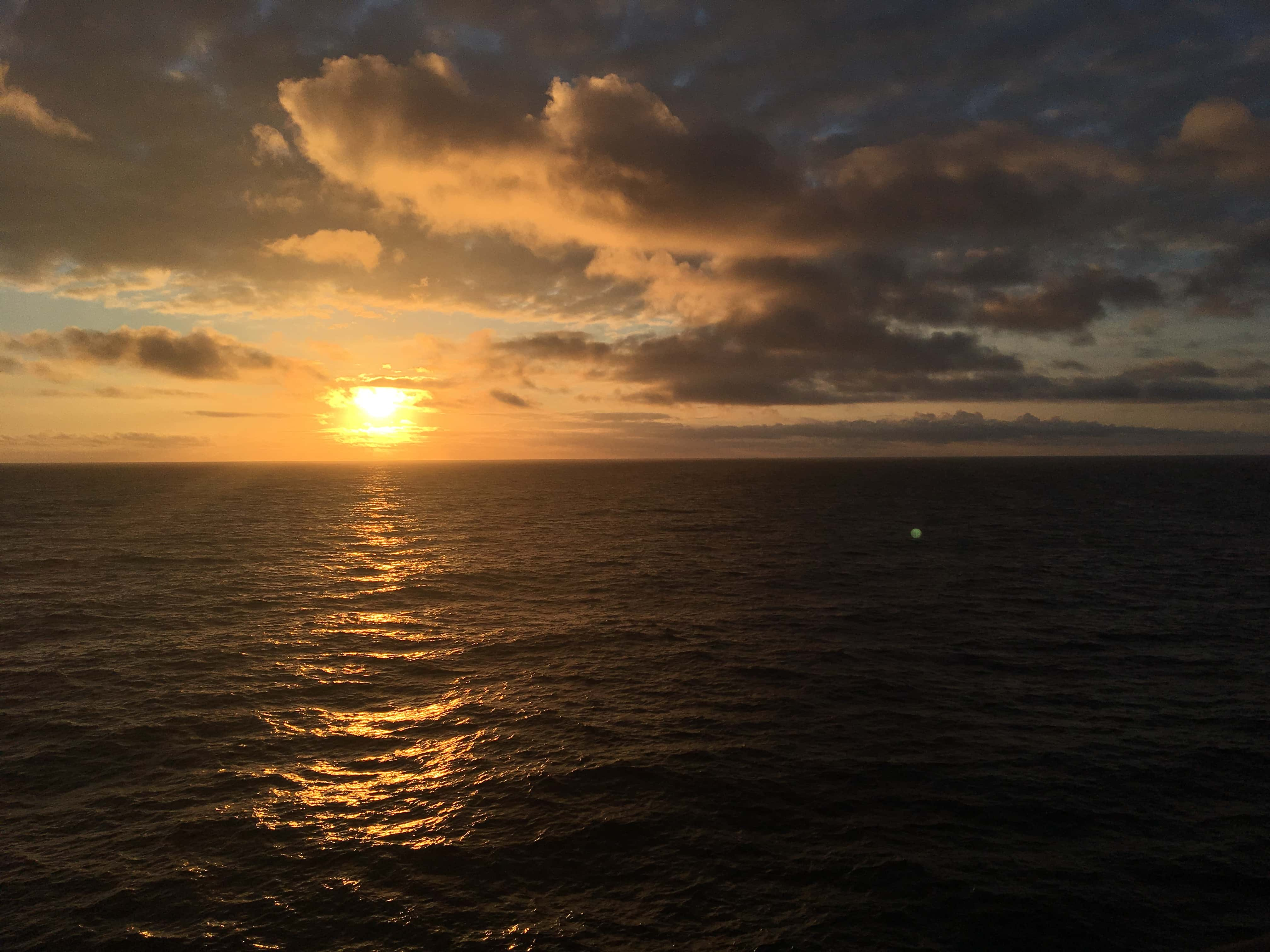 norway norwegian fjords cruise sunset midnight sun over the ocean