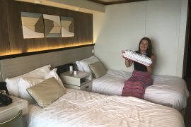 p&o britannia balcony cabin reviews review woman sat on bed with inflatable cruise ship