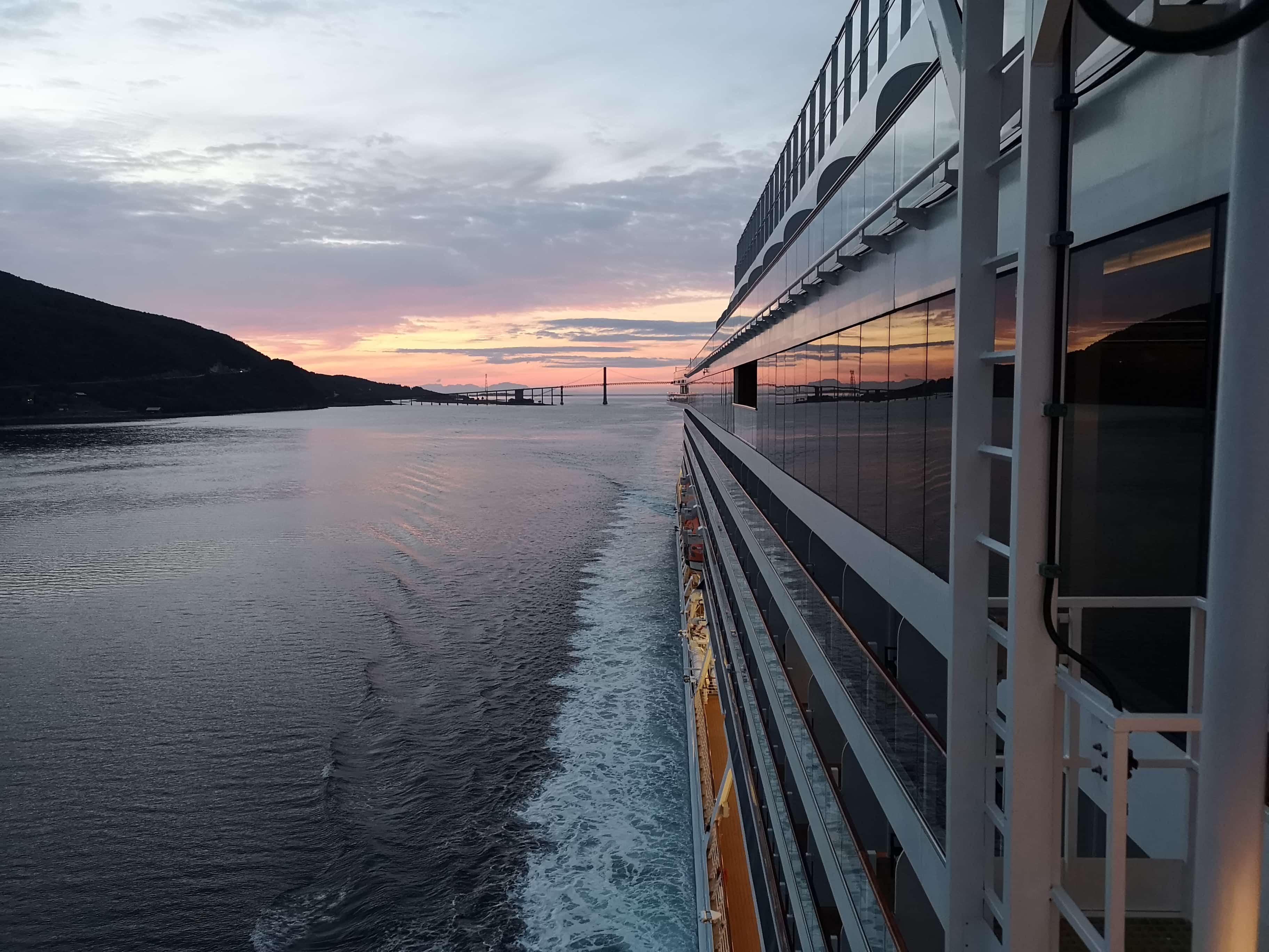 Viking Sea - Midnight Sun Norway Reflection of Sunset in windows of cruise ship