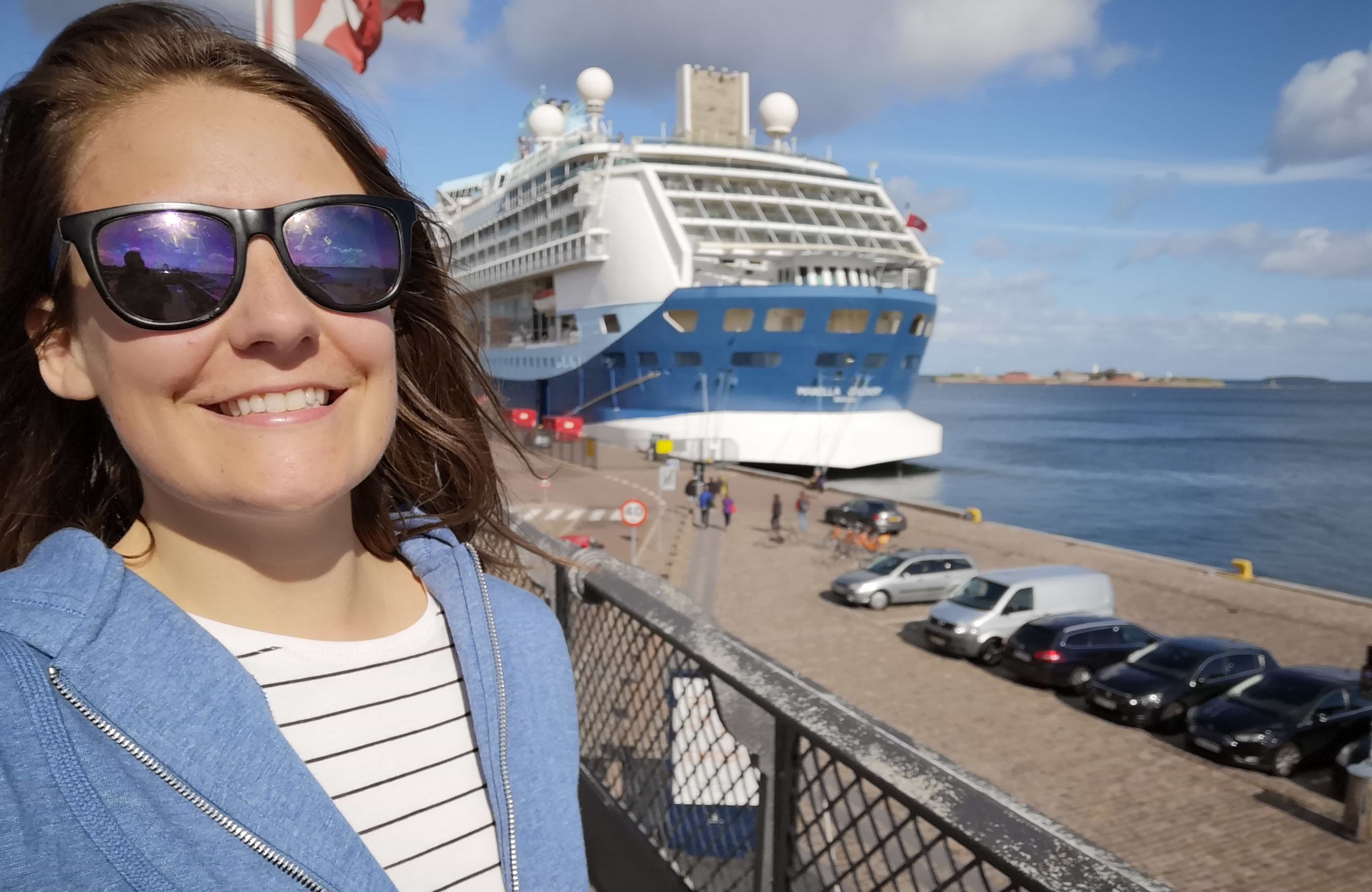 girl and cruise ship marella discovery in copenhagen