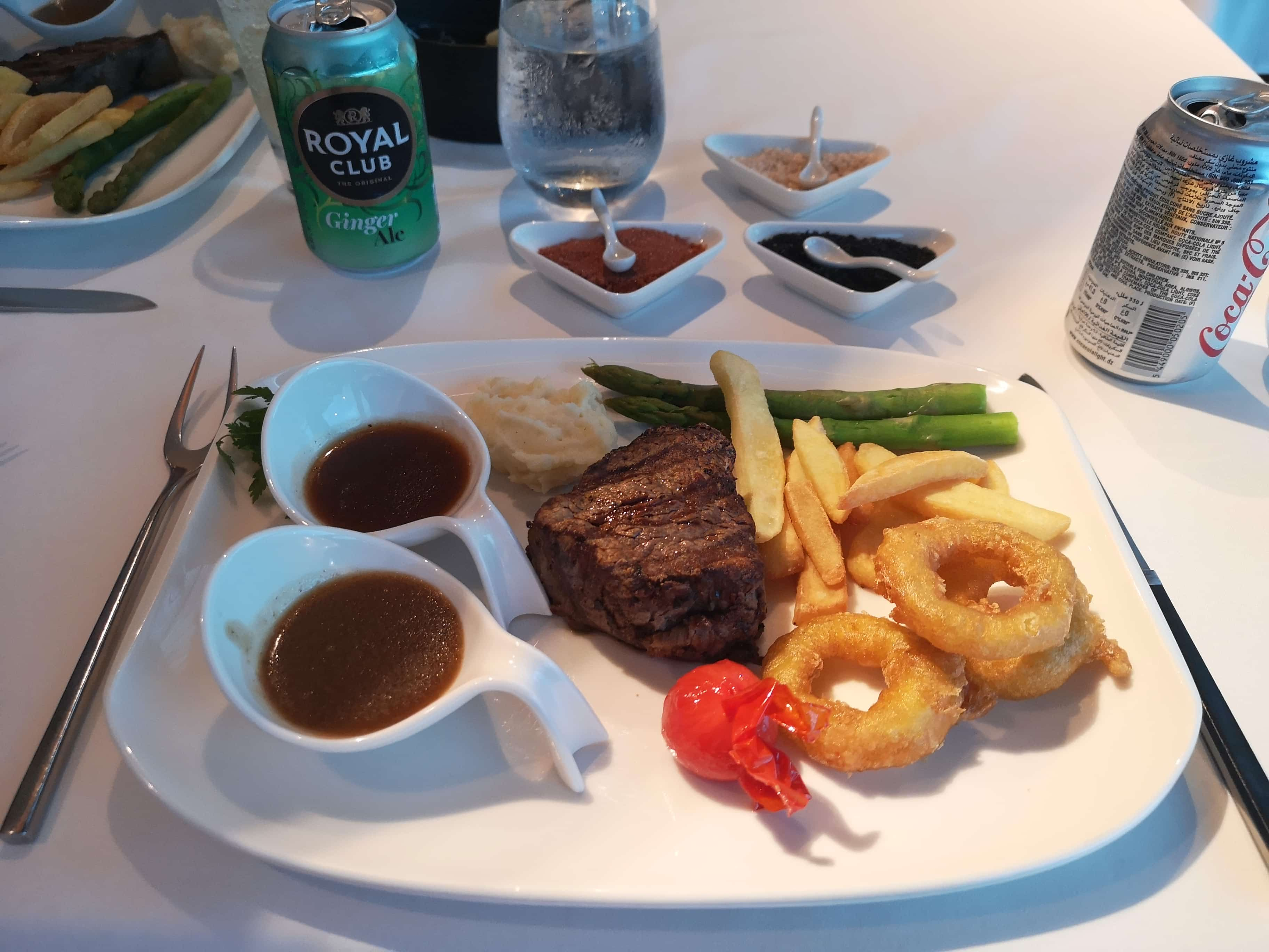 Marella Discovery Surf and Turf Steak  Onion Rings Chips Coke