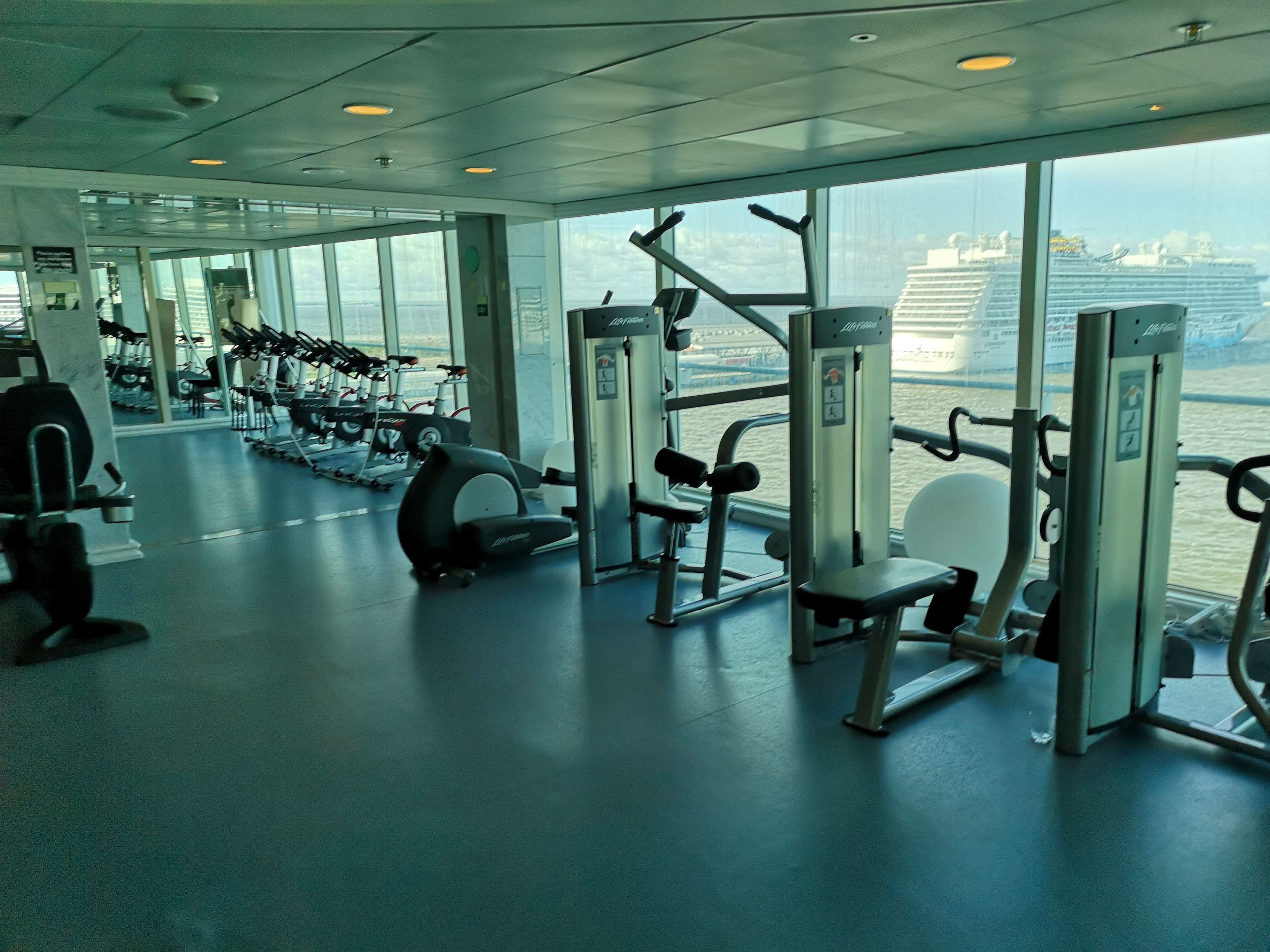 Marella Discovery Gym with Norwegian Breakaway in the background