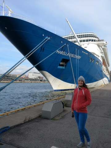 Marella Discovery Cruise Ship Hull  Girl in hat and jeans