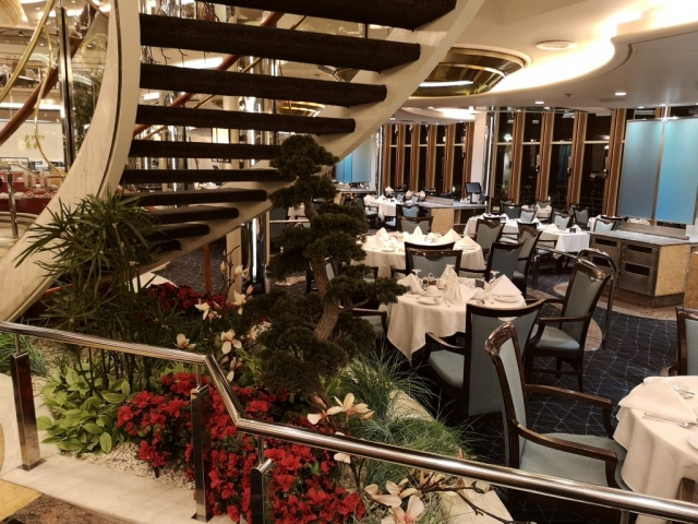Marella Discovery Main dining room 47 degrees  under stairs plants attention to detail