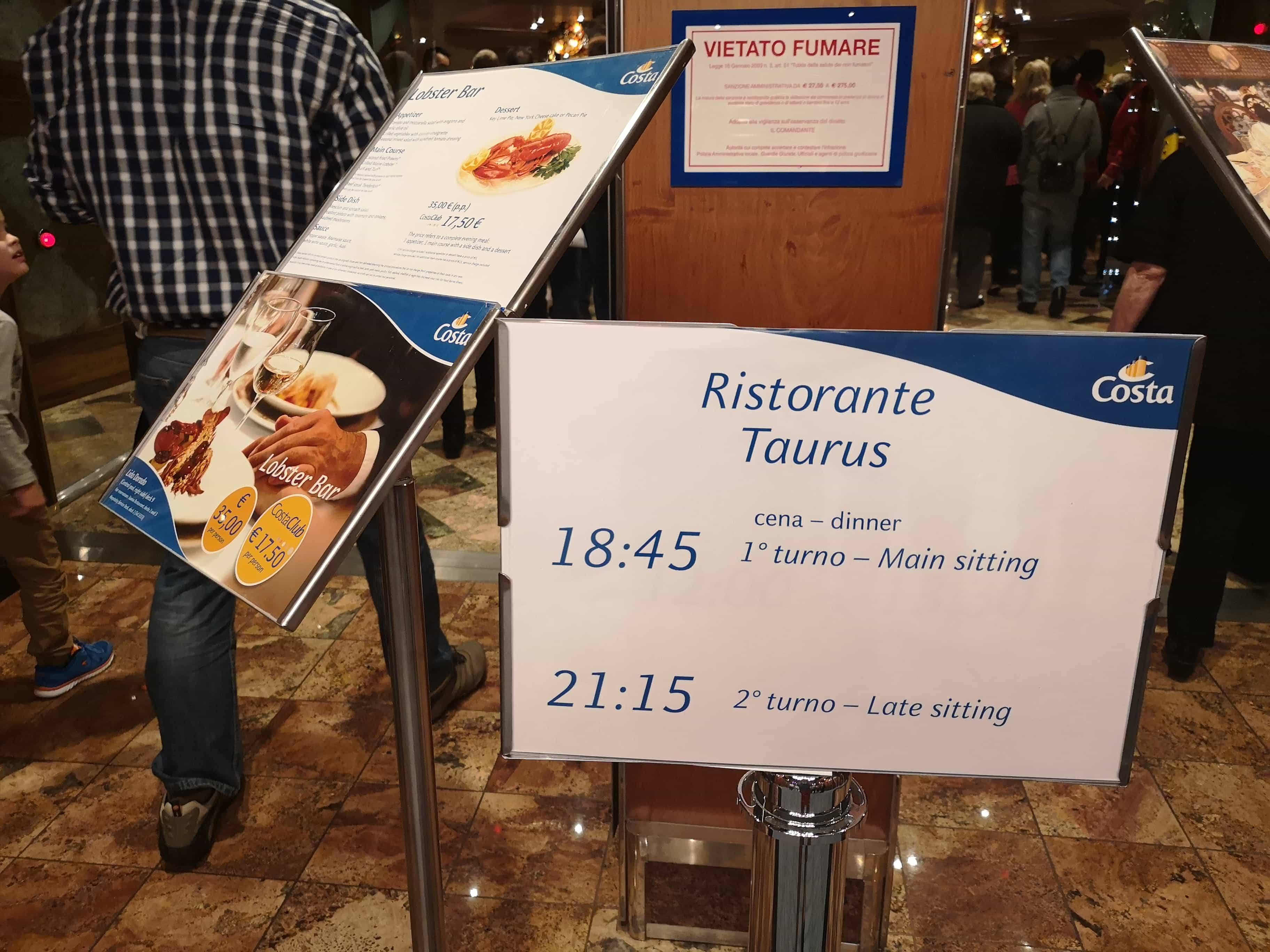 Costa Cruises Dining Times Sign Outside Restaurant 18:45 and 21:15