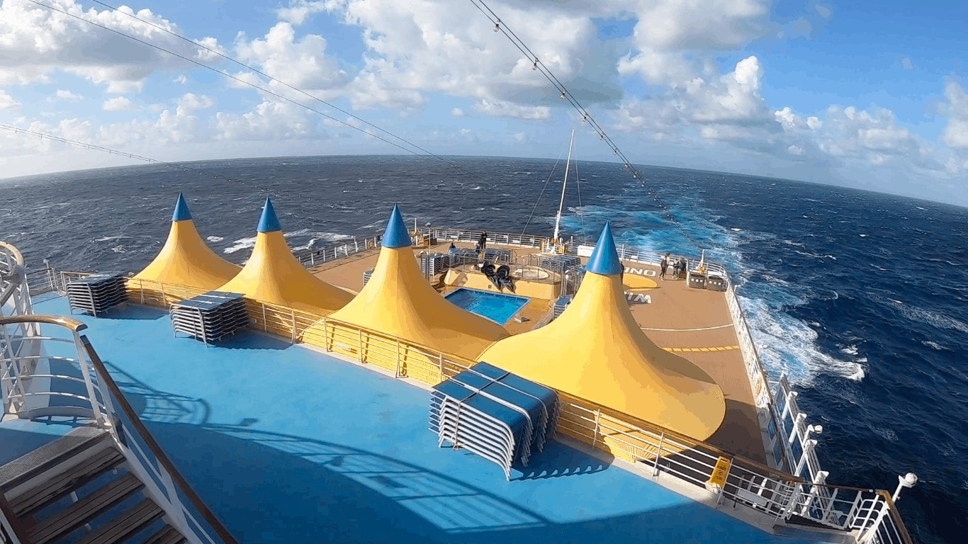 Costa Cruise Yellow Tents Canopies Back of Cruise ship with ocean and horizon