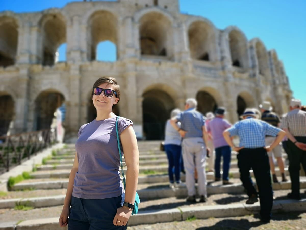 Emerald Waterways Arles Tour amphitheatre girl in sunglasses on steps