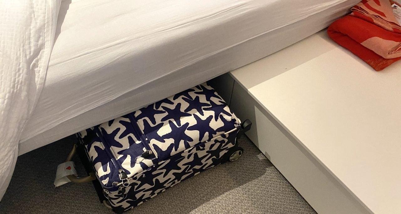 Virgin voyages cabin suitcase under bed